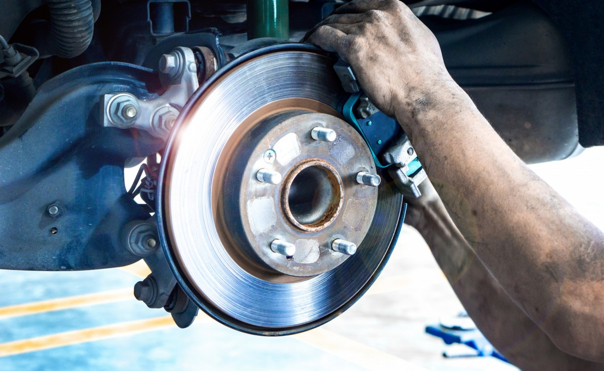 man putting on brake pads